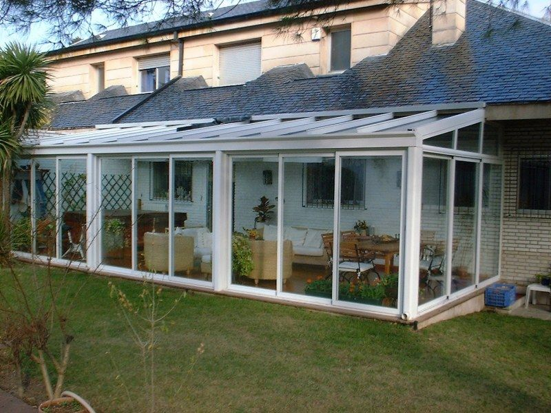 Cerramiento de terraza con puertas correderas de aluminio for Tejabanes para terrazas