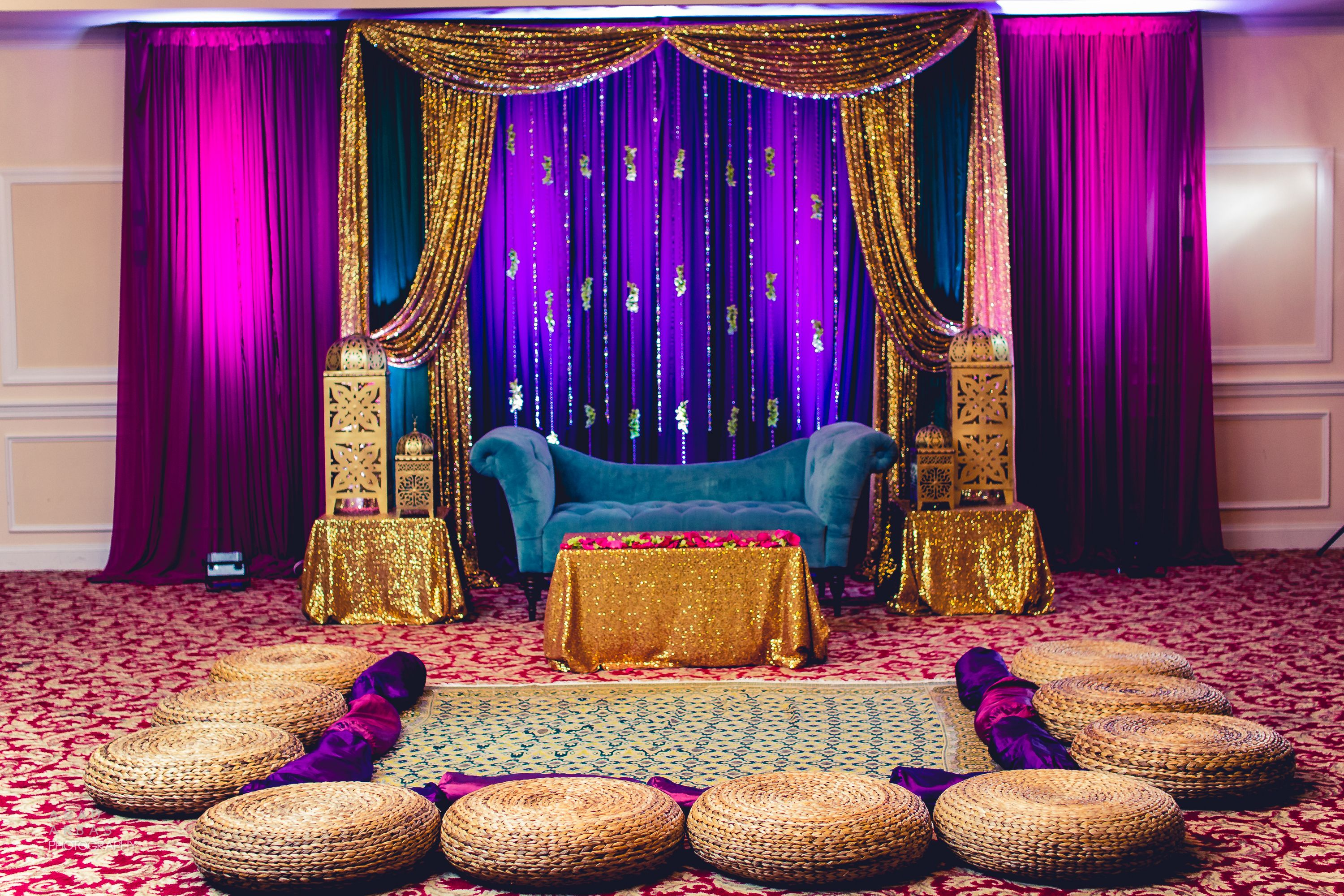 Bold gem tones for the mehndi sangeet dholki stage for Backdrops decoration