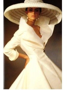 white dress with a big hat