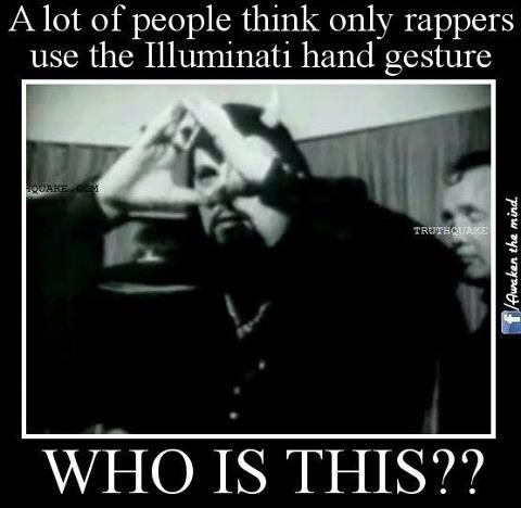 Open your eyes people!!!  This is high priest of satanism Anton LaVey.  Notice how he does the illuminati triangle sign. This represents the all seeing eye of horus/satan!!!
