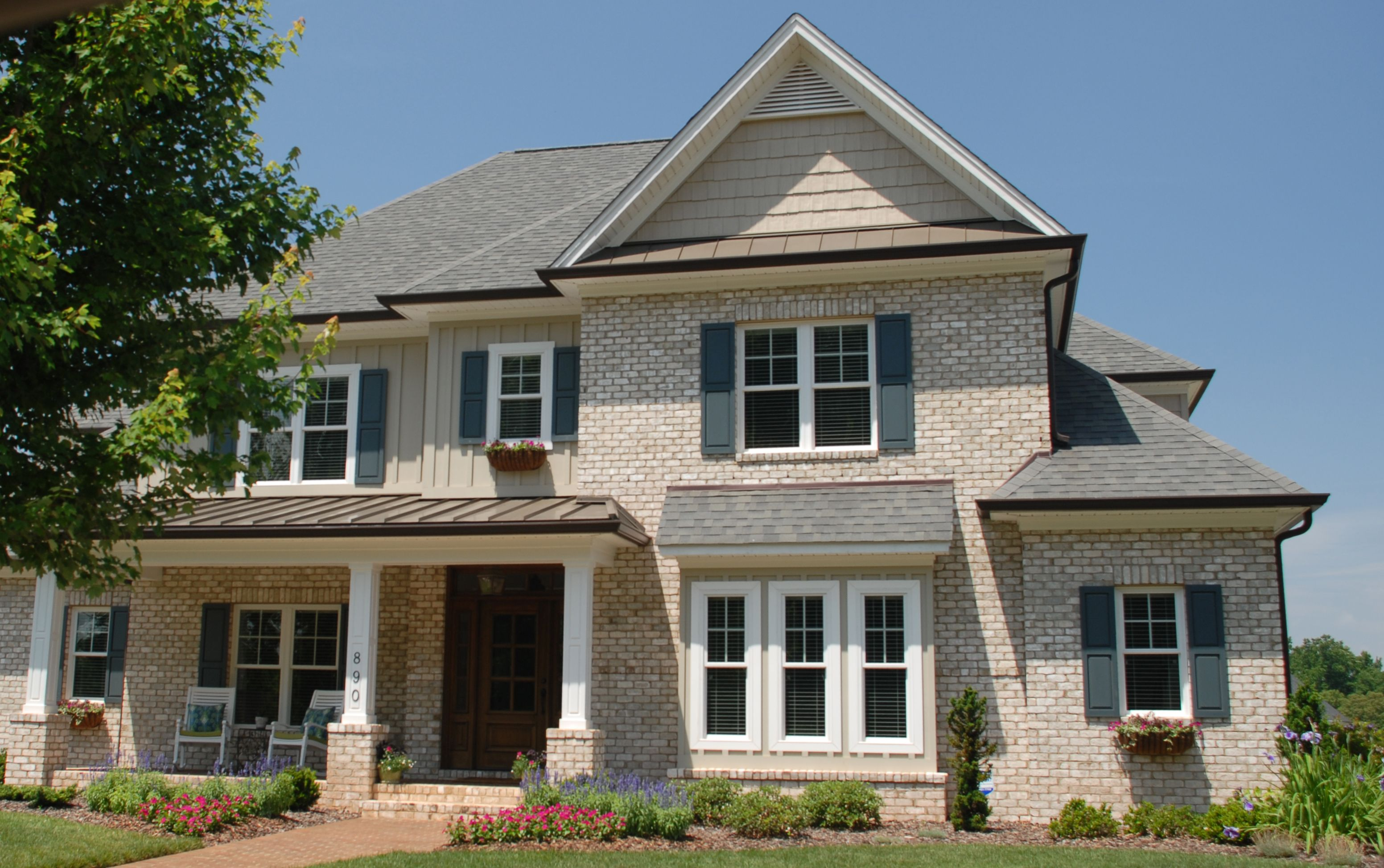 Chesapeake Pearl Oversize Tumbled Tidewater Pine Hall Brick - Stained exterior shutters