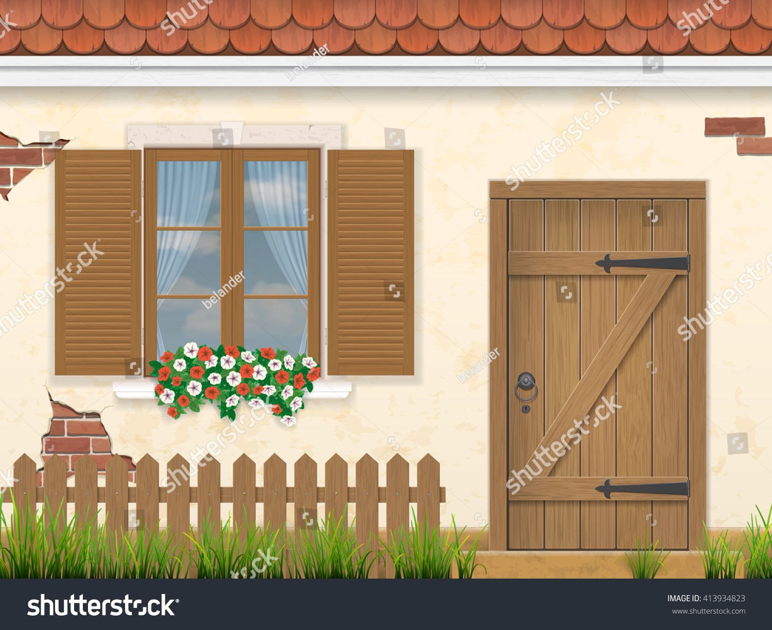 wooden window door and fence with grass in