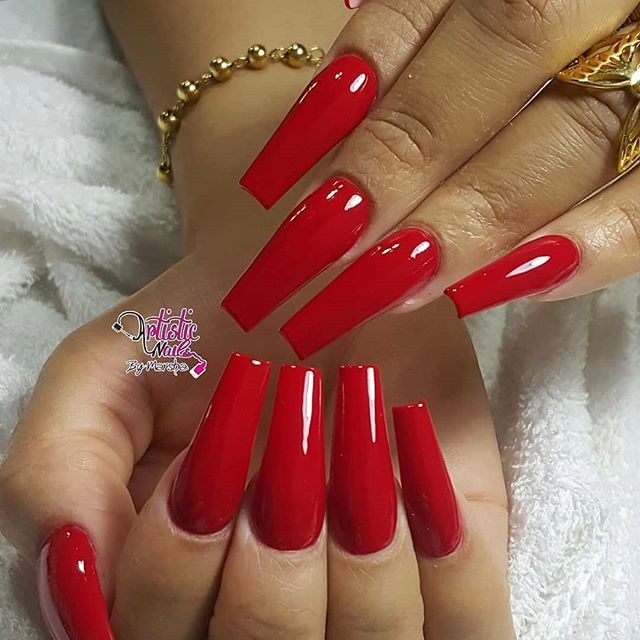 Long coffin shaped nails with bright shiny classic red gel polish ...