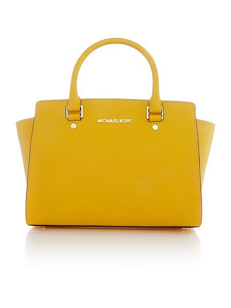 e9fb9549034c Add Sunshine to your accessories with Michael Kors
