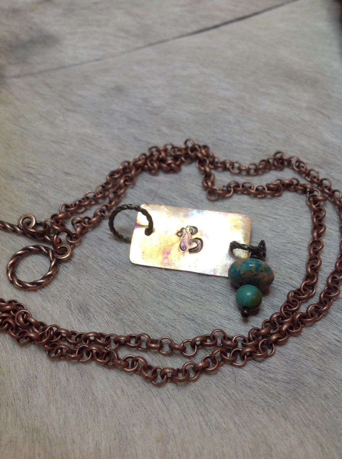 A personal favorite from my Etsy shop https://www.etsy.com/listing/213723843/om-symbol-stamped-copper-necklace