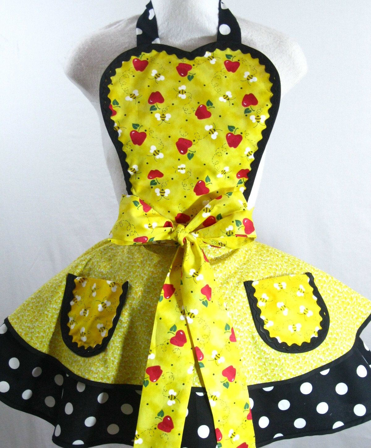 Bubble Bee Apron with cute apple accents and polka dots. $55.00, via Etsy.