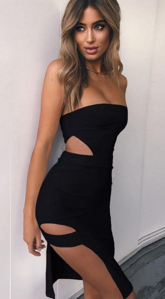eeb3f7e604 Tight strapless black dress with revealing slits in all the right places.  Ideal when you want to look your most sassy!