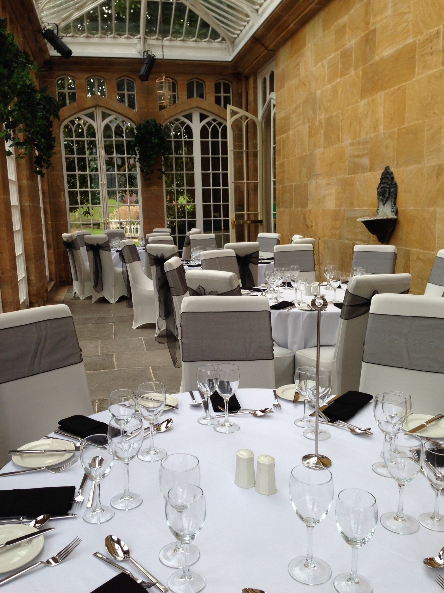 chair covers yeovil white leather arm dillington house somerset black sash on ivory