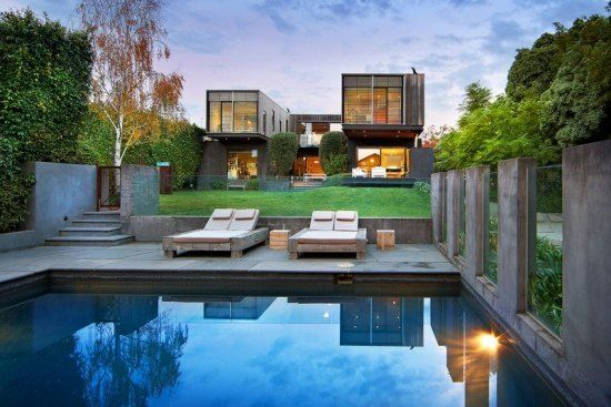 Modern house swimming pool concrete and glass garden fence