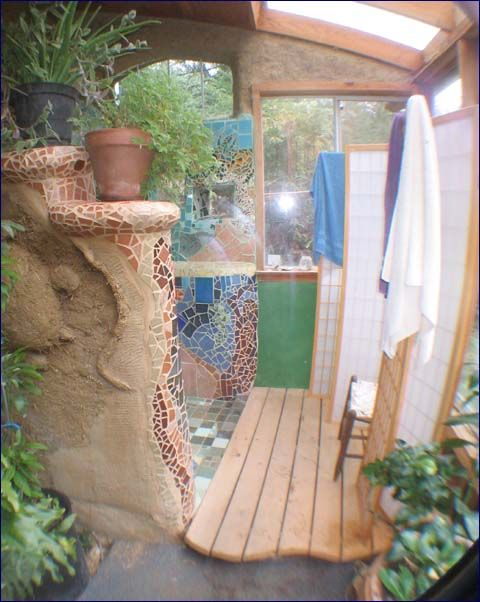 This is an outdoor cob shower area