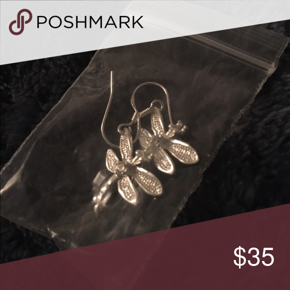 Sterling Silver Dragonfly Earrings Brand new, never worn. Real Sterling Silver earrings. I got them as a Christmas present but I'm not much into jewelry. Bundle with the ring for a cheaper price. Jewelry Earrings