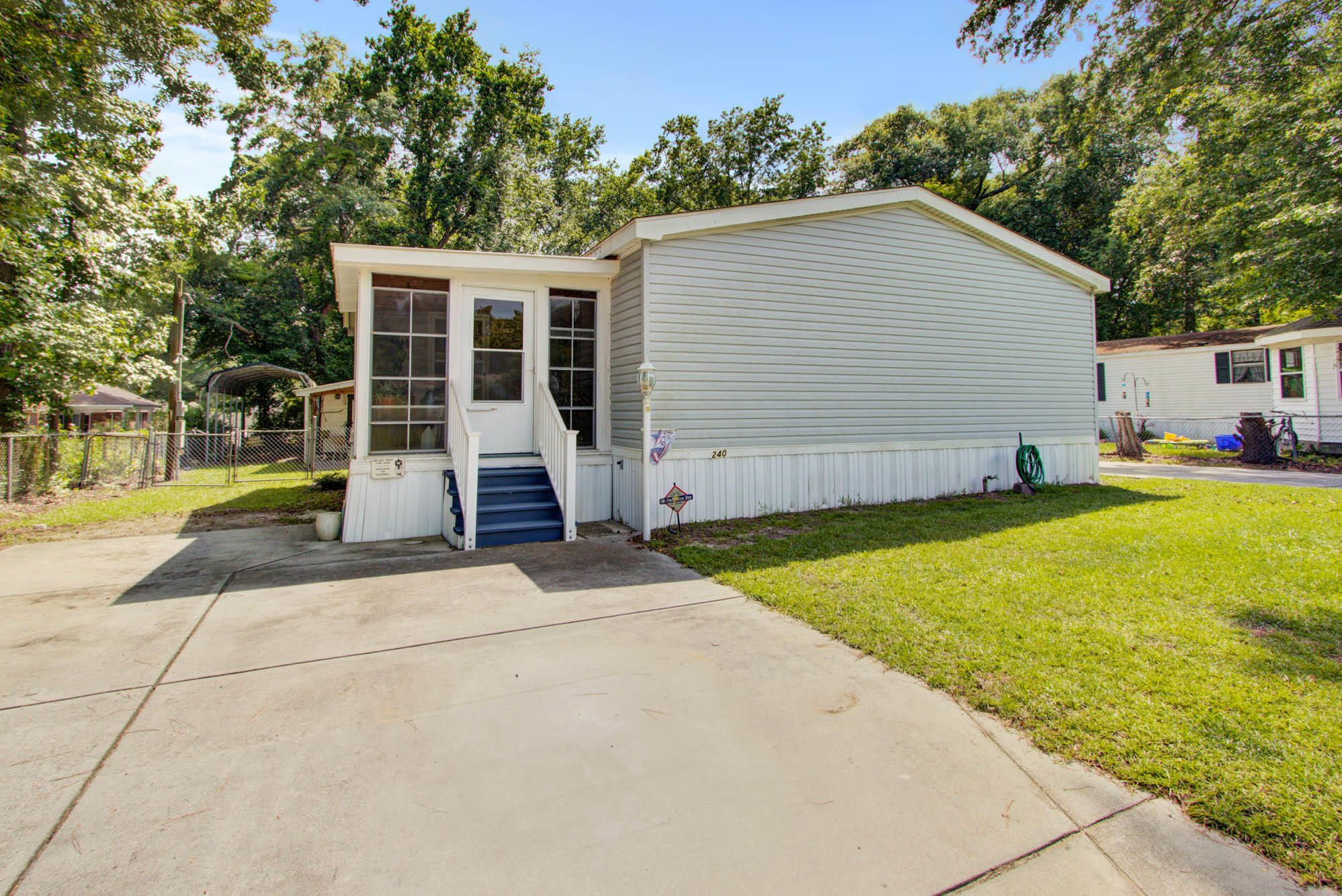 Cute mobile home on a corner lot with a neighbor on one