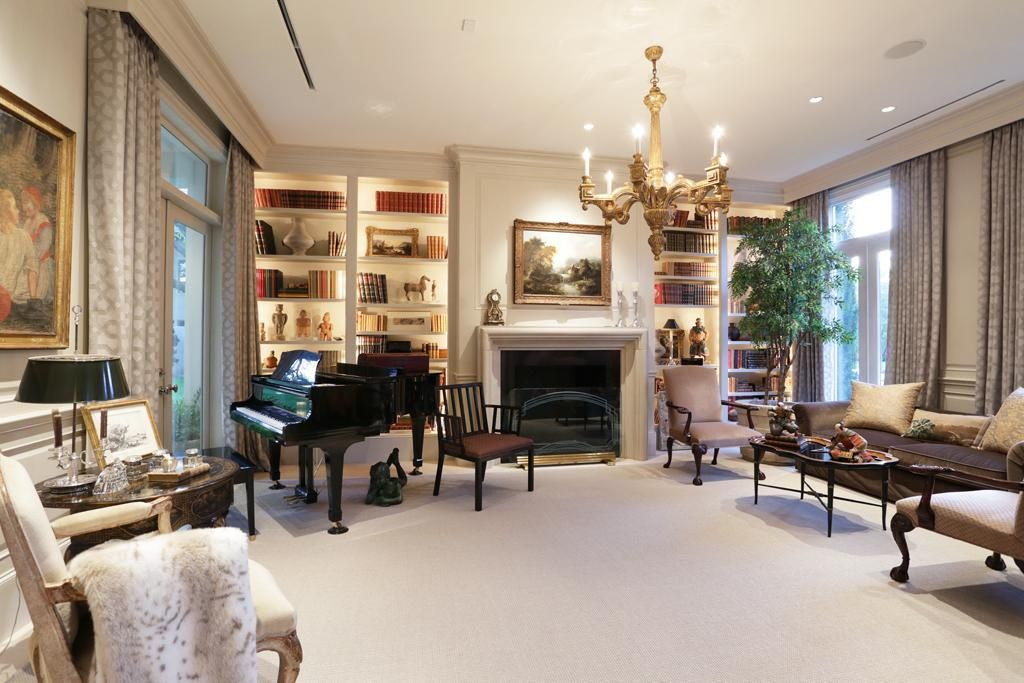 Formal living room/library features built in book shelves