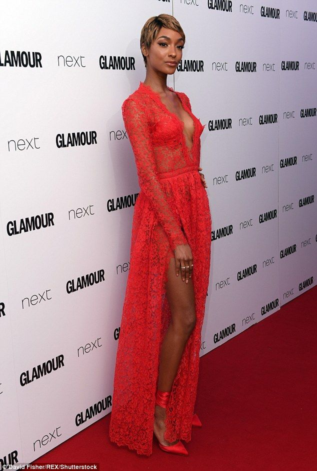 https://sunbelz.com/2017/06/06/super-model-jourdan-dunn-is-a-show-stopper-in-red-sheer-lace-thigh-high-split-gown-with-plunging-neck/
