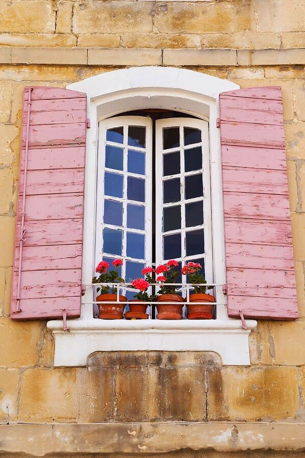 French window, pink shutters, window box with flowers