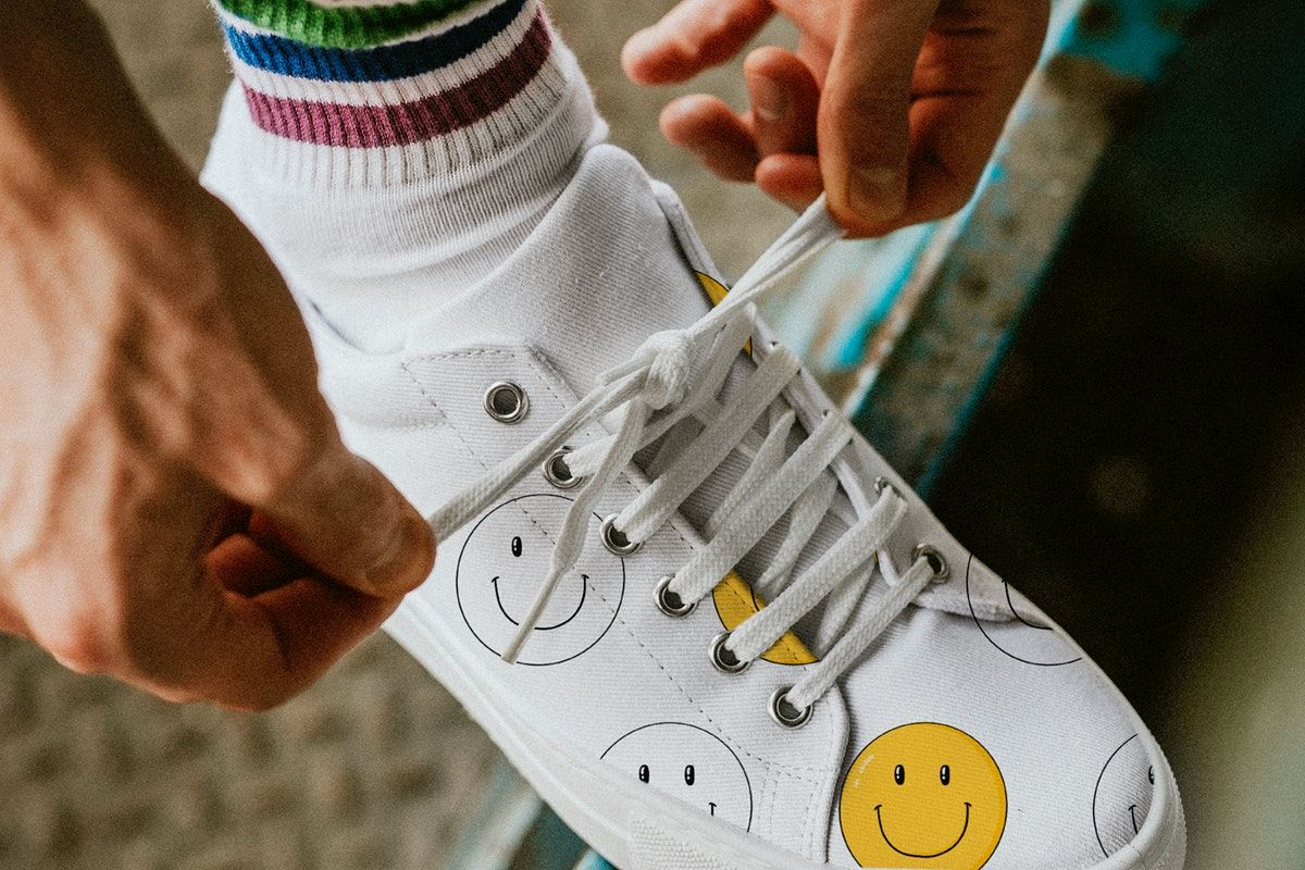 Download Download Premium Illustration Of Man Tying Shoelaces On Canvas Sneaker