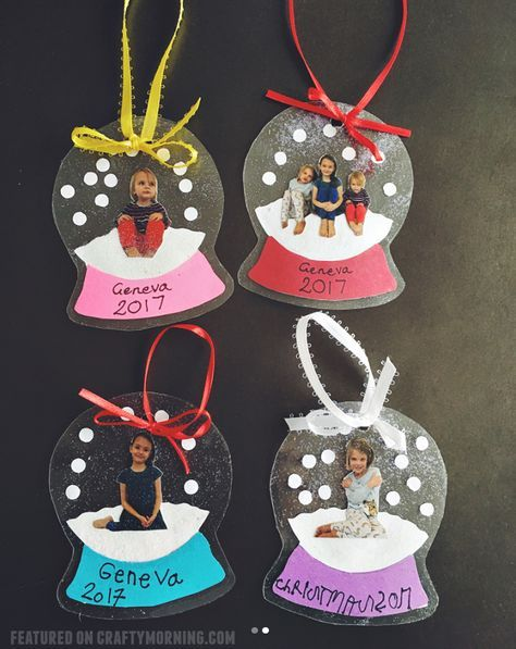 "These darling little photo snowglobe ornaments were made by Megan Hayashi! Here's her tutorial…""Painted inside of one side of a laminating sleeve. Placed picture on top and added some glitter. Then laminated with clean side of sleeve on top. The base is made out of cardstock paper."" What a cute Christmas gift for parents and … #parenting"