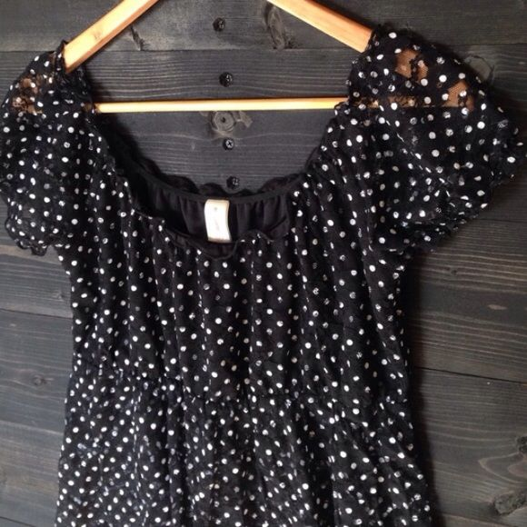 Black and white lace top Black and white lace polka dot top. The chest does have a black lining but the rest of the shirt is sheer No Boundaries Tops Tees - Short Sleeve