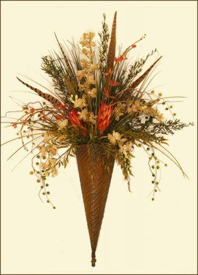 World market inspired aurora brown wall sconce with an assortment of feather grass and orchid silk flower wall sconce metal wall accent mightylinksfo Image collections