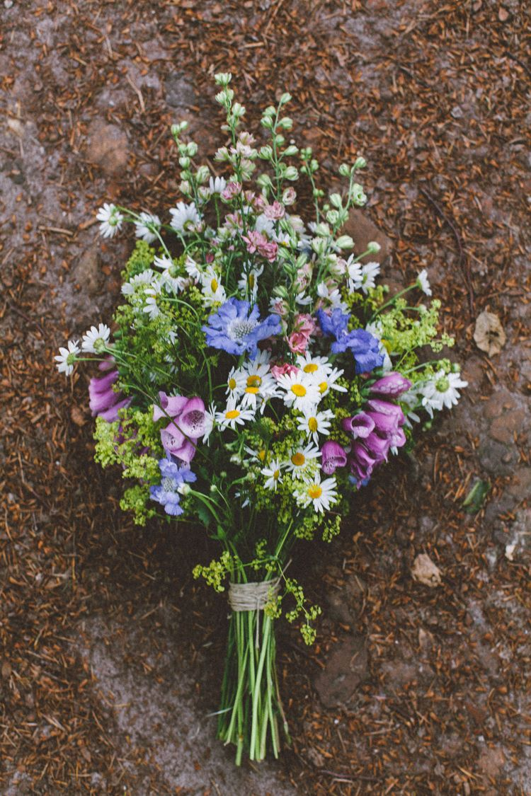 Bohemian wedding in the woods wild forest flowers bouquet daisies