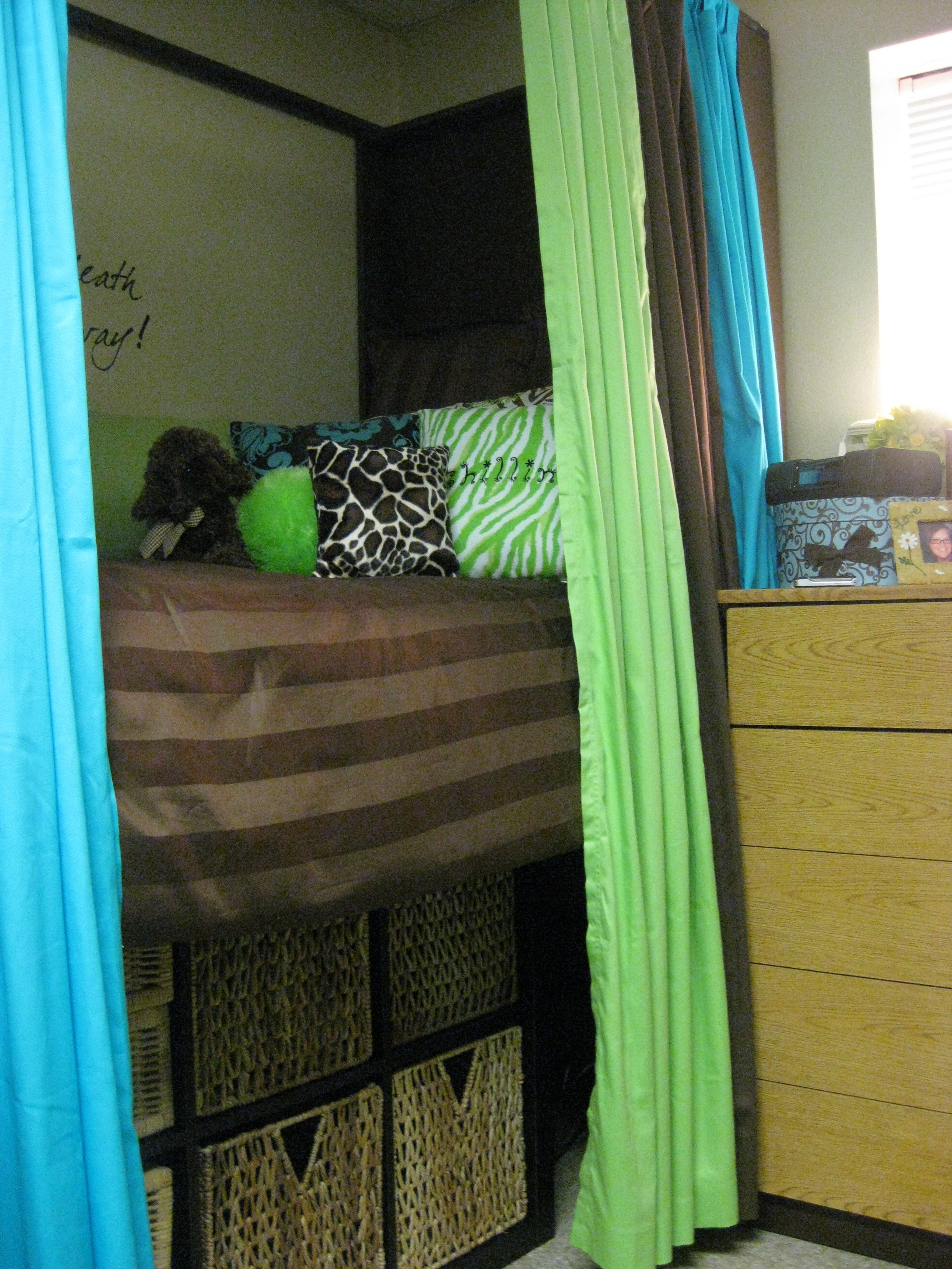 Dorm room loft bed ideas  Shelving with baskets for extra storage from IKEA The bed frame was