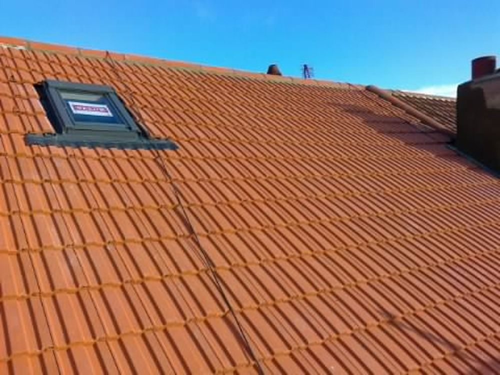 Redland 49s roof (terracotta) with velux window roofing