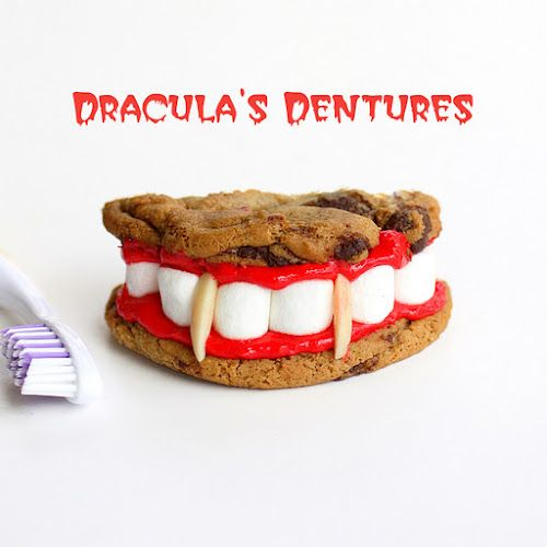 Vampire Teeth Cookies!  (vanilla frosting tinted red, marshmallows and almond slivers)  http://www.ssdgsmiles.com