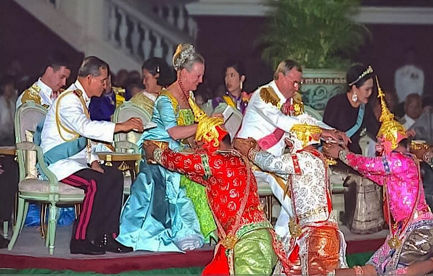 Prince Henrik, Queen Margrethe II and Crown Prince Frederik of Denmark attend a state banquet provided by the King and Queen of Thailand February 8, 2001 at the Chakri Throne Hall in Thailand. After the banquet the Royal families were given gifts and watched a performance of traditional Thai dancers.