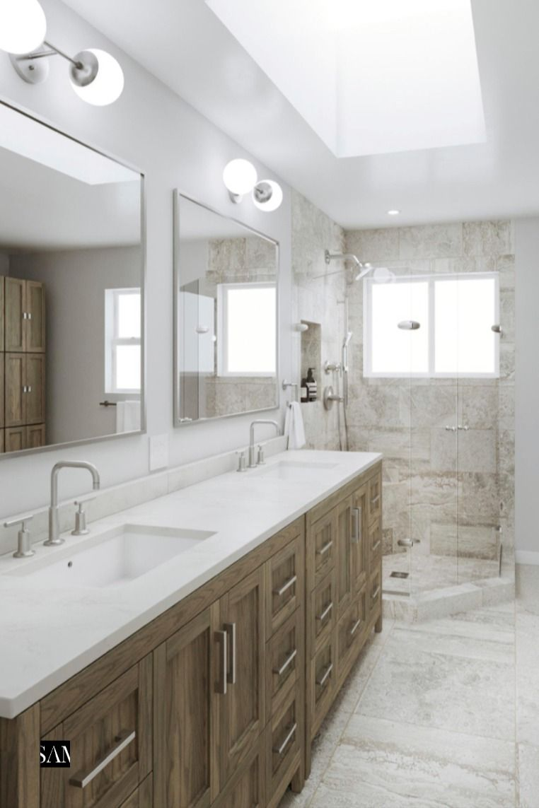 Capturing clean modern tile technology, this Master Bathroom uses porcelain Travertine for year after year durability. Bathed in natural light the space combines storage cabinets in Dusky Oak with quartzite countertops and brushed nickel finishes. #interiordesign #design #interior #home @Daltile #interiors #masterbathroom #tile #shower #vanity #decoration #luxury #interiorstyling #interiordecor #bathroom #renovation #housegoals @Kohler #houseenvy #homeinspo #tilestyle @SamanthaBlack #BlkApproved
