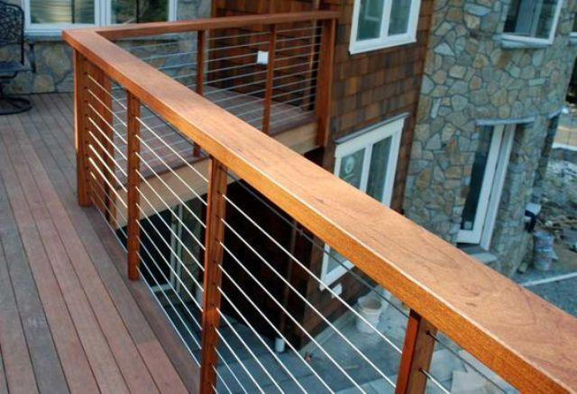 36 Outdoor Deck With Warm Wood Posts Cable Railings Digsdigs Cable Railing Deck Deck Railings Deck Railing Design