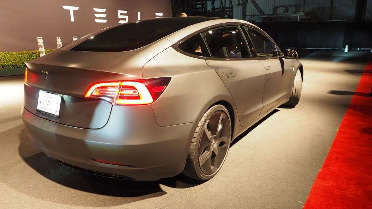 The Tesla Model 3 arrives with 215 miles of range for
