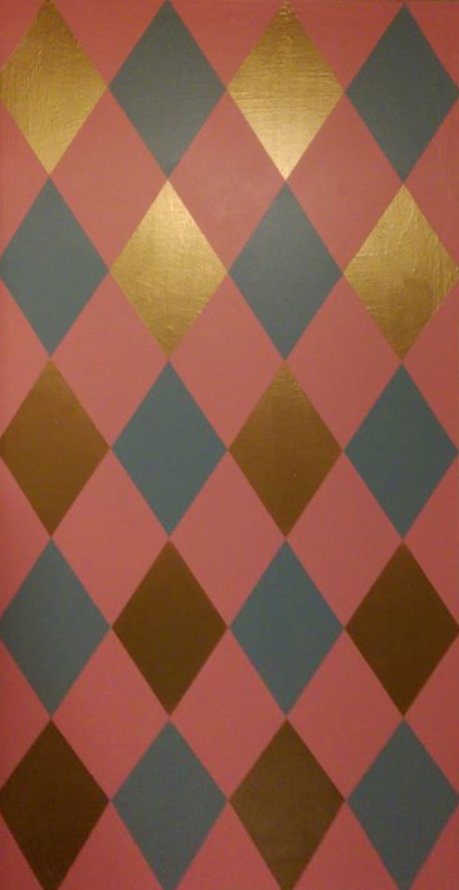 Three color harlequin patterned wall painted for my wife