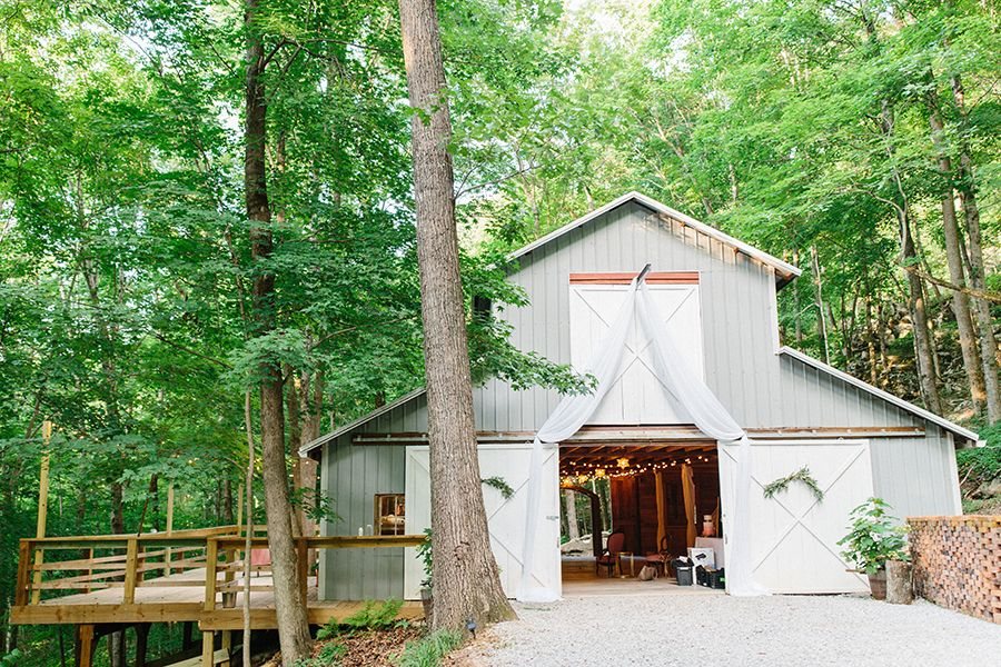 gray barn wedding venue, barn in forest in mountains ...