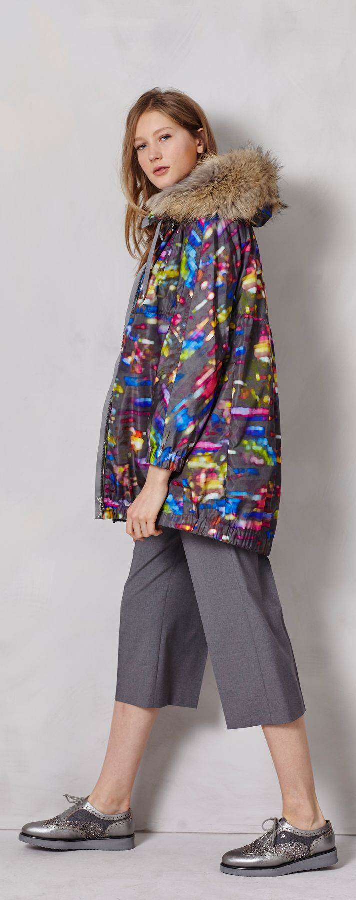 Flashing lights in a city where the weather can't seem to make up its mind! Keep warm yet comfortable in this light nylon jacket with a colorful, futuristic lights print and detachable fur lining on the hood. But still stay cool in a business-chic pair of culottes.