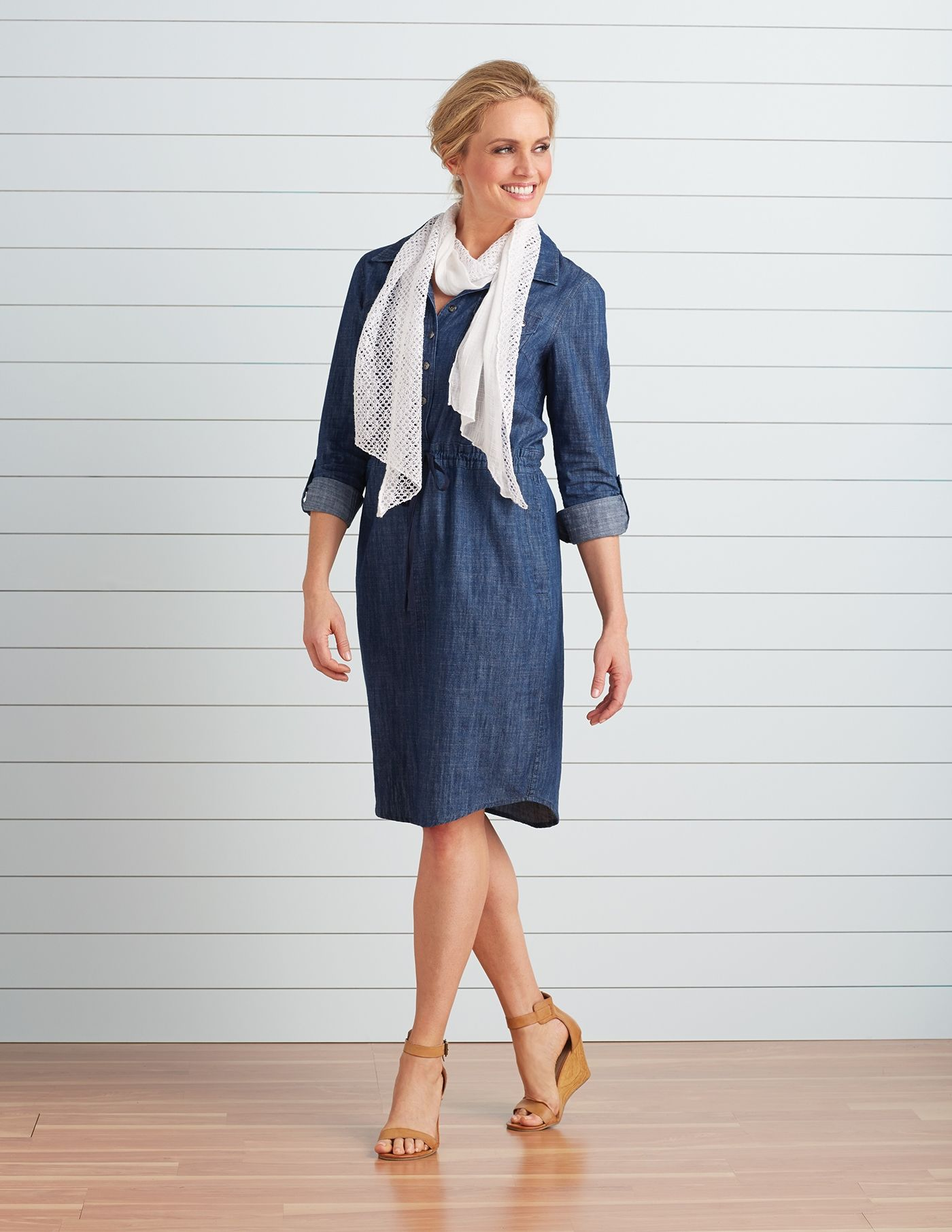 A lightweight denim dress with a synched in waistline is easy and