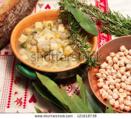 chickpea soup with aromatic herbs and raw chickpea - stock photo