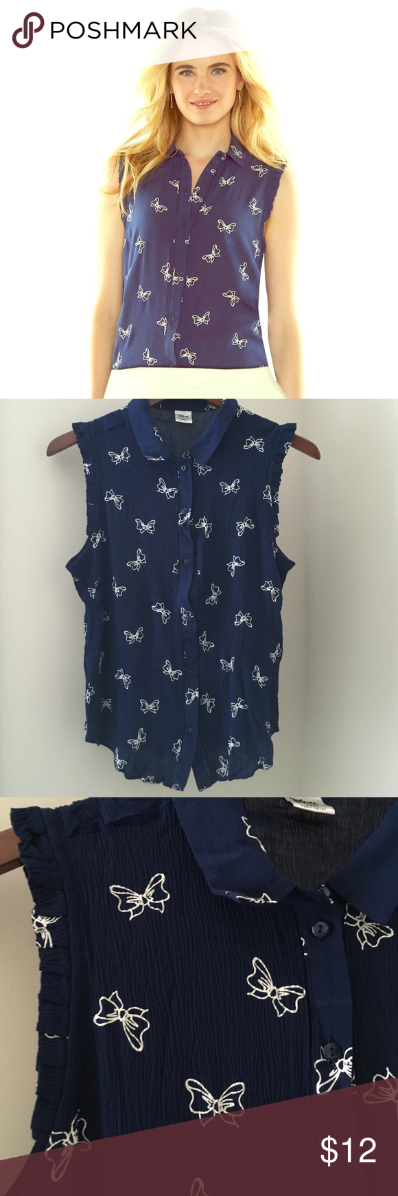 Disney by Lauren Conrad sleeveless blouse Adorable navy blue button down sleeveless blouse from Lauren Conrad's Disney collection.  Ruffle detail around the arm and Minnie Mouse bow print. Excellent condition! LC Lauren Conrad Tops Blouses