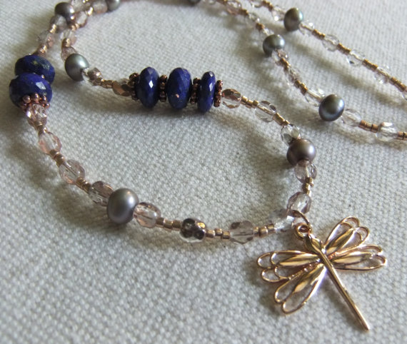 Deep blue faceted lapis lazuli rondelles blend with grey freshwater pearls, fire polished rose tinted crystals, galvanized rose gold seed beads,