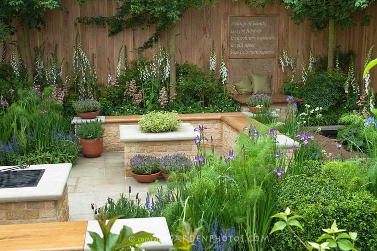 Beautiful Herb Patio Garden: Keats A Thing Of Beauty Is A Joy Forever Motto  On Garden Fence Wall, With Bench, Cushions, Place To Relax, Foxg.