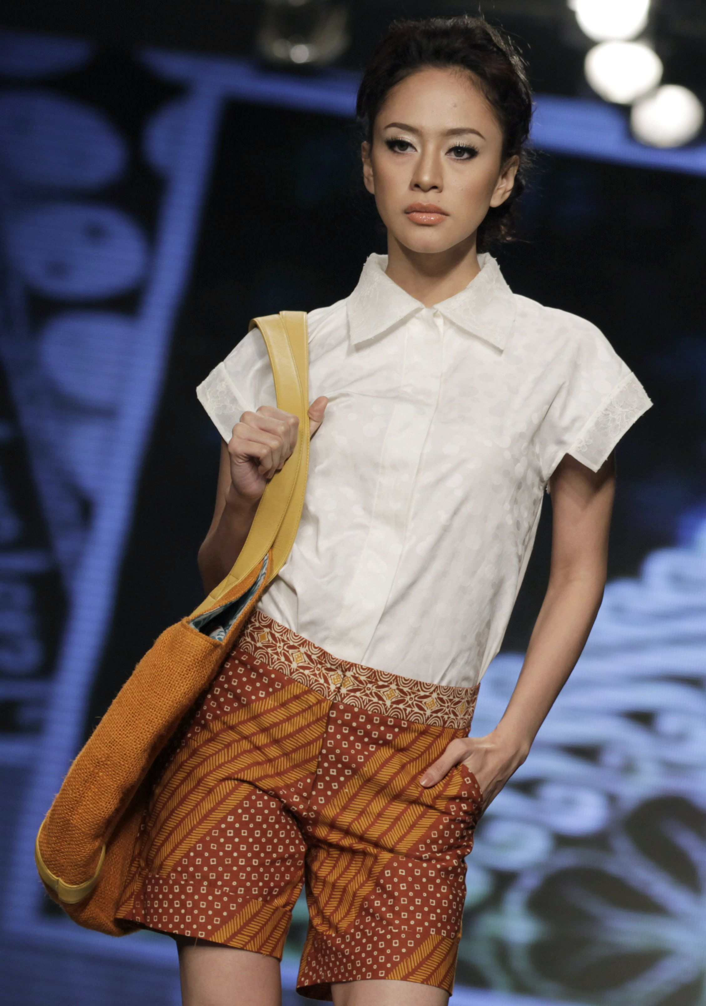 A model presents a creation by Indonesian fashion designer Widhi Budimulya during the Jakarta Fashion and Food Festival in Jakarta Indonesia on Wednesday