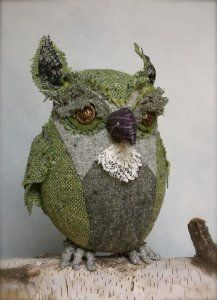 green perching owl by Ann Wood $255.00 Green Perching Owl: handmade from a variety of vintage and antique garments. He is approximately 7 inches from toe to horn. He has vintage button eyes and is stuffed with organic wool.