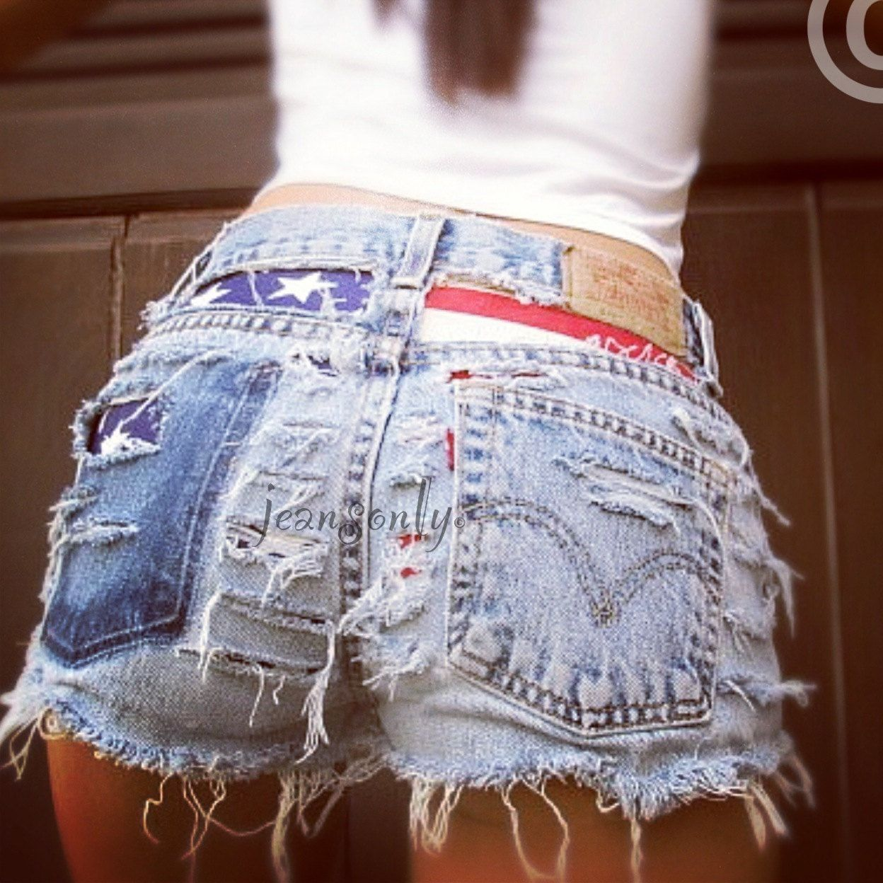 88e6207043 Vintage Levis High waisted destroyed American flag shorts by Jeansonly.  $54.99, via Etsy.
