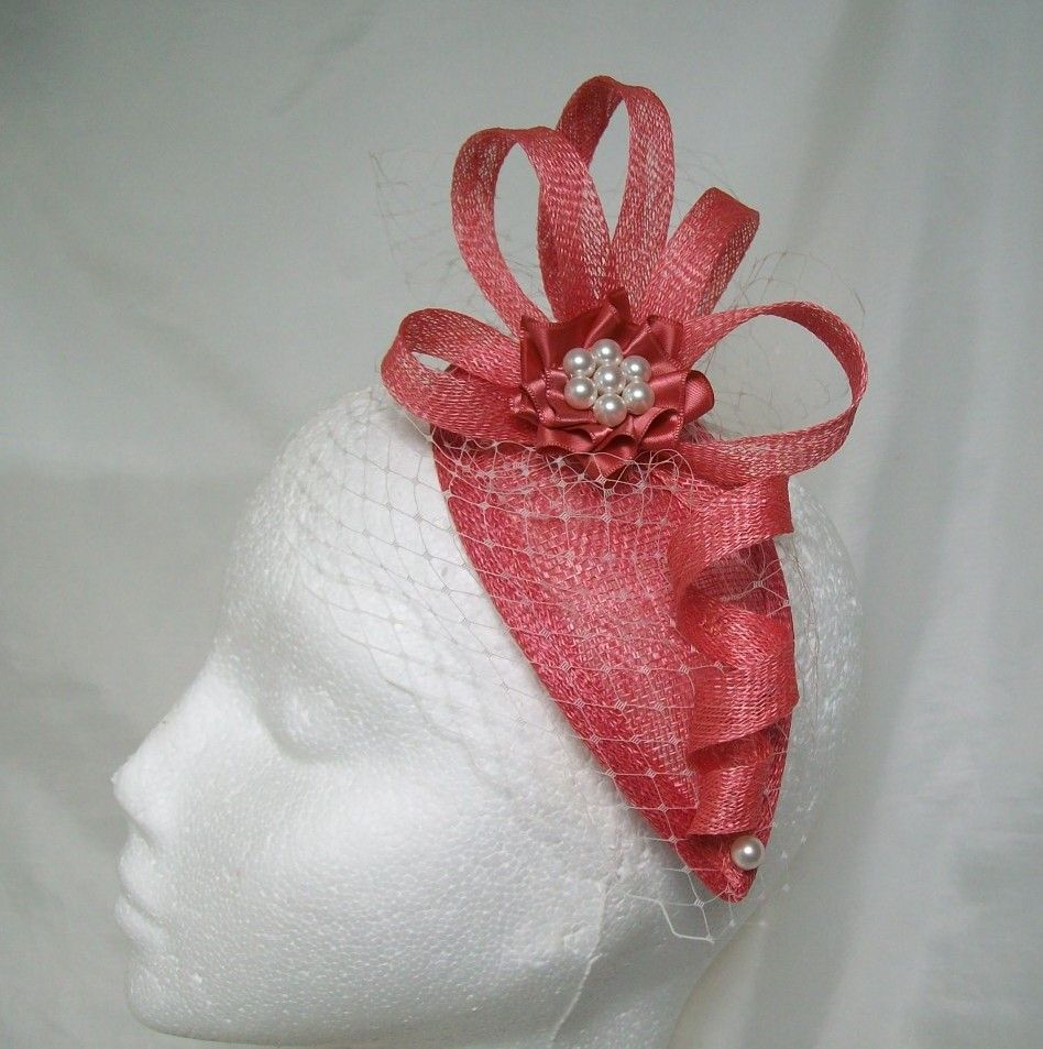 Coral & Ivory Beatrice Teardrop Fascinator Mini Hat. Order Now from www.indigodaisyweddings.co.uk Specialising in stunning bespoke cocktail fascinators and formal hats in a wide range of colours, perfect for Royal Ascot and The Kentucky Derby. Plus all your wedding floral accessories including shoe clips, vintage flapper bands, feather and flower fascinators, feather fans, fairy wands, wrist corsages, wedding bouquets & buttonholes. Worldwide Delivery.