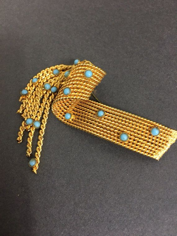 Hey, I found this really awesome Etsy listing at https://www.etsy.com/uk/listing/491928944/brooch-pin-turquoise-gold-drop-vintage