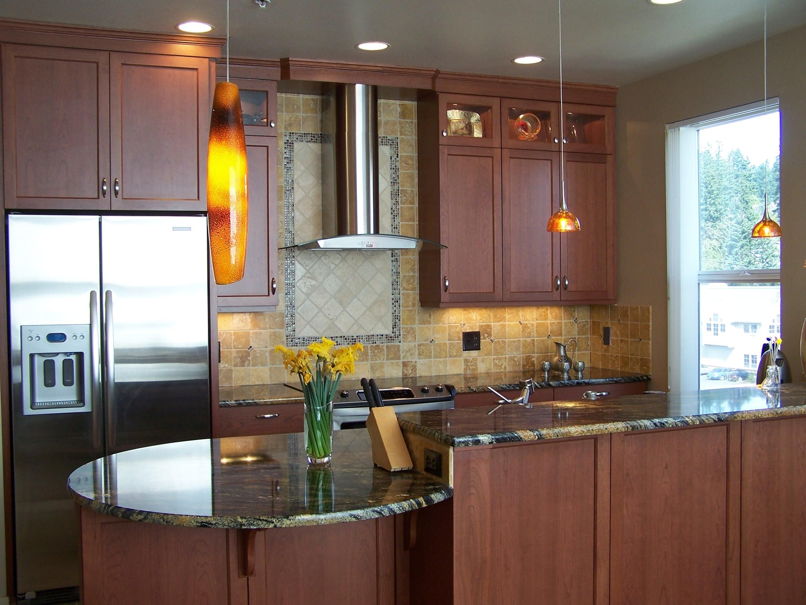 Cherry wood stained cabinets; shaker door style; granite ...