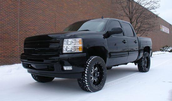 Black 2009 Chevy Silverado with 4 inch ReadyLift lift kit Winnipeg