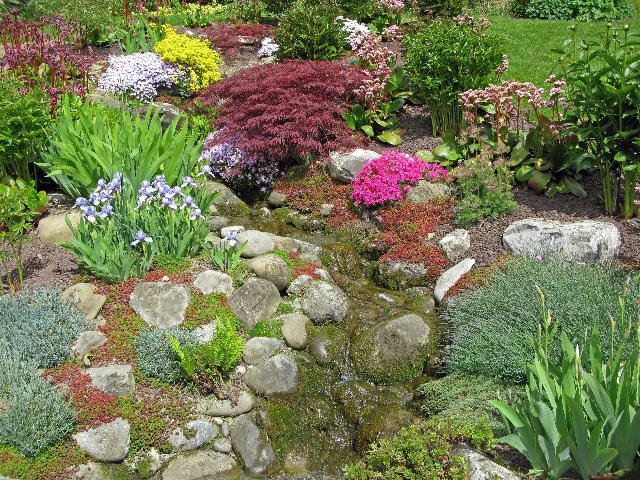 Problem areas call for landscape solutions, including rock garden design, which is an attractive, practical solution where landscaping often fails.