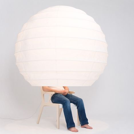 Chair tucked inside a giant paper lampshade that can be folded down chair tucked inside a giant paper lampshade that can be folded down to create a private mozeypictures Image collections
