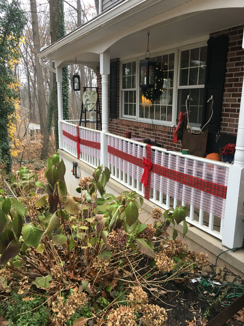 Use Decorative Mesh And Plaid Ribbon To Make Your Front Porch Railing Look Like A Wrapped Present Christmas Porch Front Porch Railings Exterior Decor