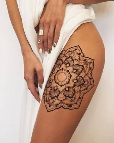 Mandala Tattoo Its Meaning and 30 Popular Designs  Page 7 of 30 is part of Thigh tattoos women, Thigh tattoo designs, Henna thigh tattoo, Henna tattoo designs, Mandala tattoo, Flower tattoos - From the wide palette of options, some of the more popular mandala tattoo designs include mandala leaves, flowers and floral mandala, lotus, Kaleidoscope